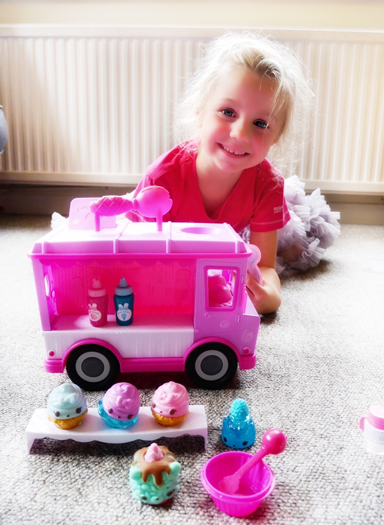 Num Noms in forground with Lip Gloss Truck and smiling girl in the background